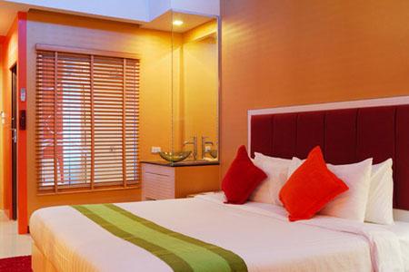 Дизайн спальни в оранжевых цветах
