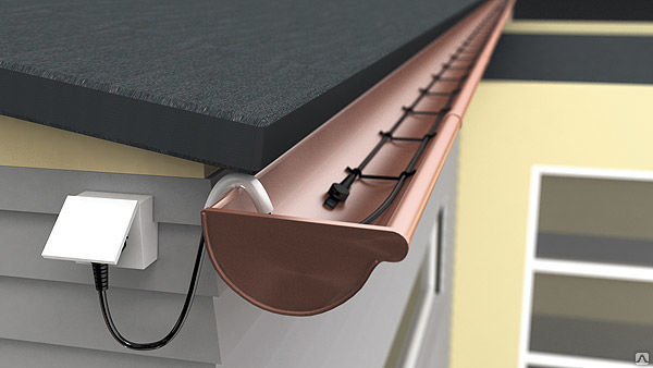 Греющий саморегулирующий кабель в кровельном стоке для защиты от замерзания..